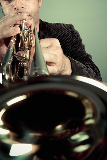 Stock Photo: 1758R-8873 Man playing a trumpet
