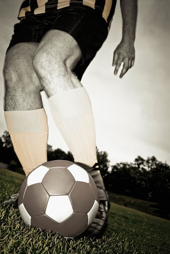 Low section view of a man playing soccer : Stock Photo