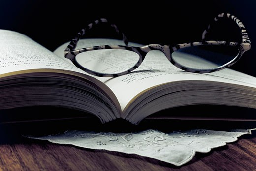 Eyeglasses on a open book : Stock Photo