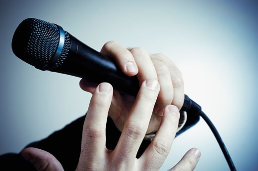 Stock Photo: 1758R-8936 Close-up of a person's hand holding a microphone