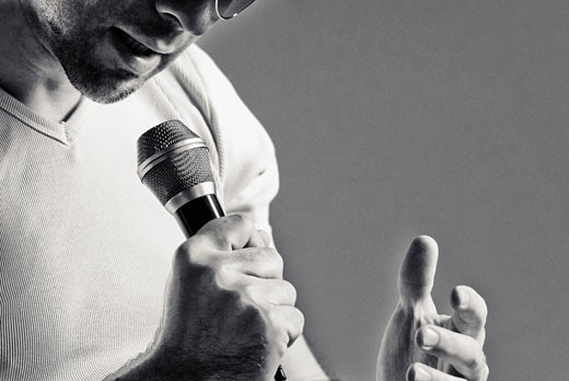 Stock Photo: 1758R-8950 Man singing into a microphone