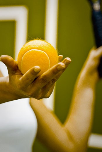Tennis player preparing to serve the ball : Stock Photo