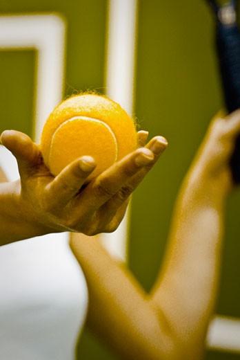 Stock Photo: 1758R-9004 Tennis player preparing to serve the ball