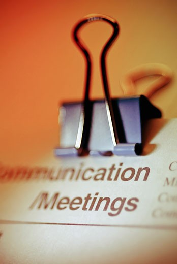 Close-up of a document with a paper clip : Stock Photo