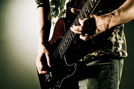 Man playing a guitar : Stock Photo