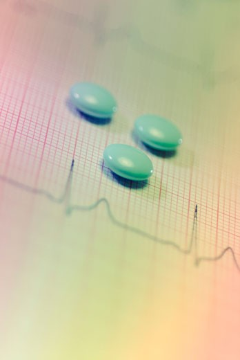 Close-up of tablets on an ECG report : Stock Photo
