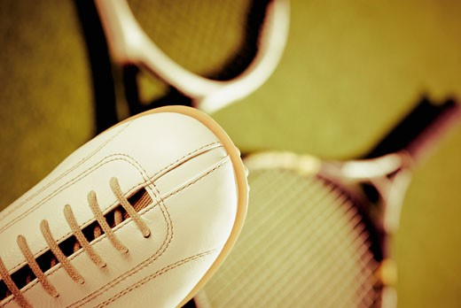 Stock Photo: 1758R-9193 Close-up of a shoe with tennis rackets