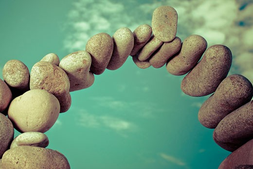 Stock Photo: 1758R-9217 Pebbles arranged in an arch shape
