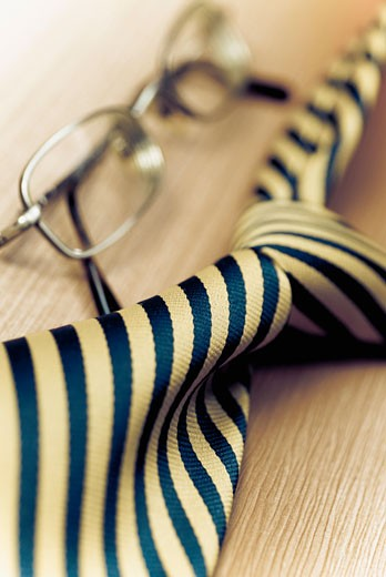 Close-up of eyeglasses with a tie : Stock Photo
