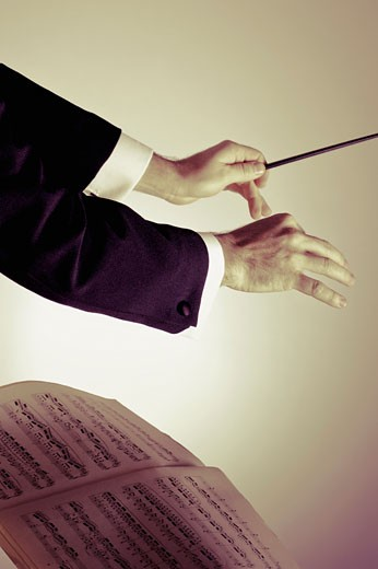 Close-up of conductor's hand holding a baton : Stock Photo