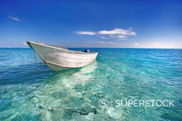 Stock Photo: 1760-10532 French Polynesia, Tahiti, Bora Bora, White boat floating on turquoise water.