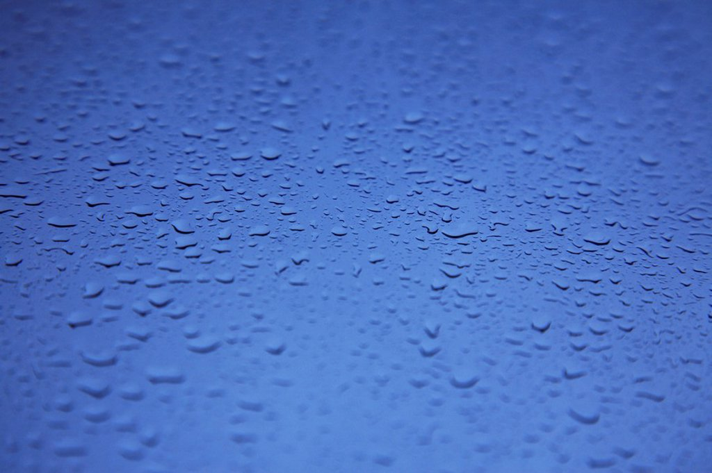 Hawaii, Oahu, Glass window with raindrops. : Stock Photo