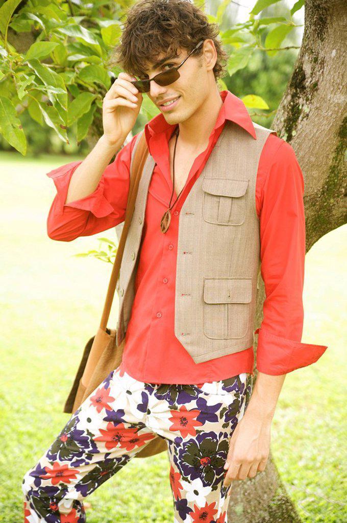 Stock Photo: 1760-11075 Hawaii, Portrait of a European Male Model in travel attire.