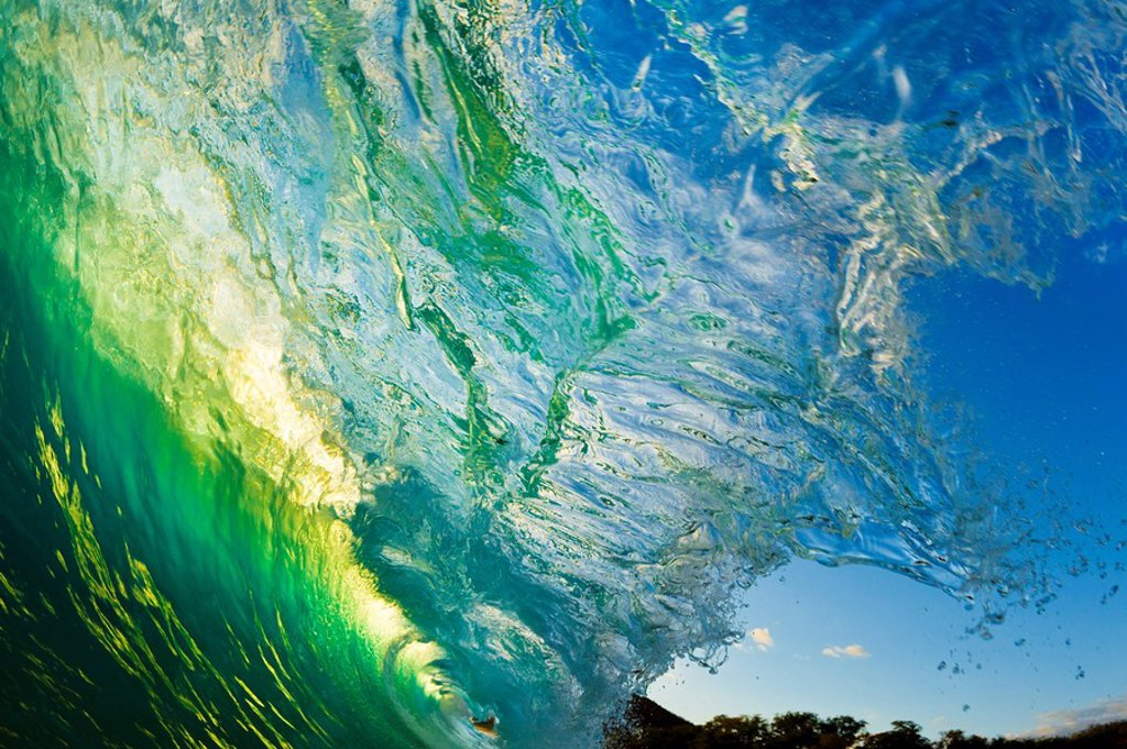 Hawaii, Maui, Makena, Beautiful wave at sunset, view from inside the barrel : Stock Photo