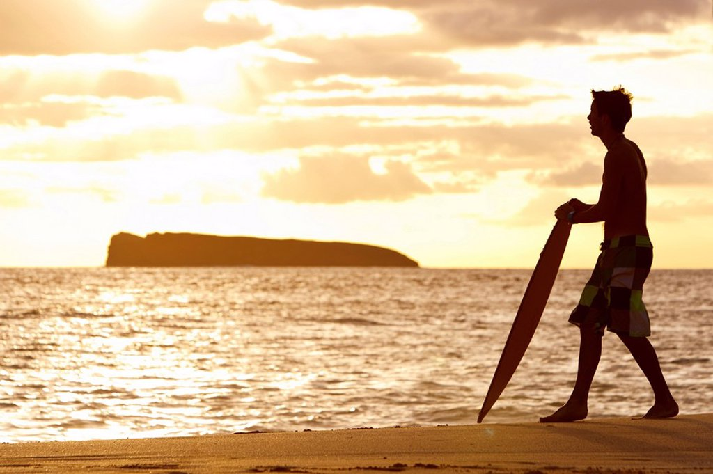 Hawaii, Maui, Makena, Skimboarder silhouette at sunset : Stock Photo