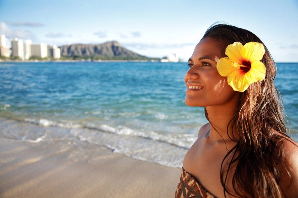 Hawaii, Oahu, Beautiful Local Polynesian Female smiling on waikiki beach with Diamond Head in background : Stock Photo