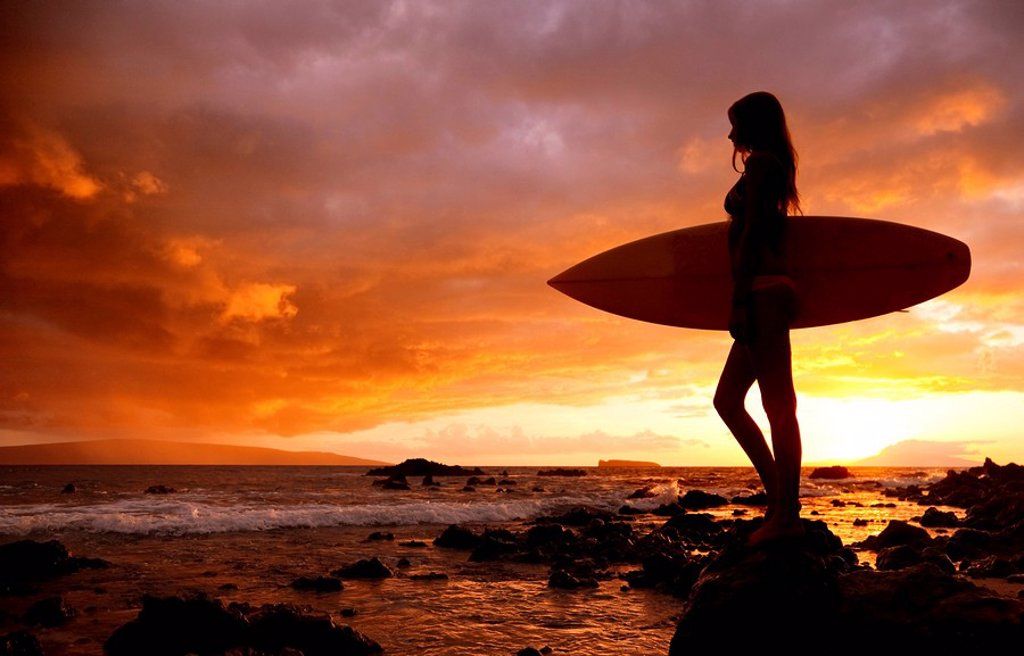 Stock Photo: 1760-12719 Hawaii, Maui, Makena, Silhouette of surfer girl at sunset
