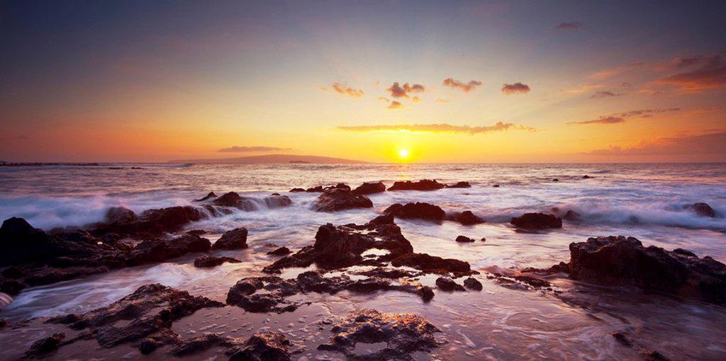 Hawaii, Maui, Makena, Dramatic vibrant sunset on the beach in south Maui : Stock Photo