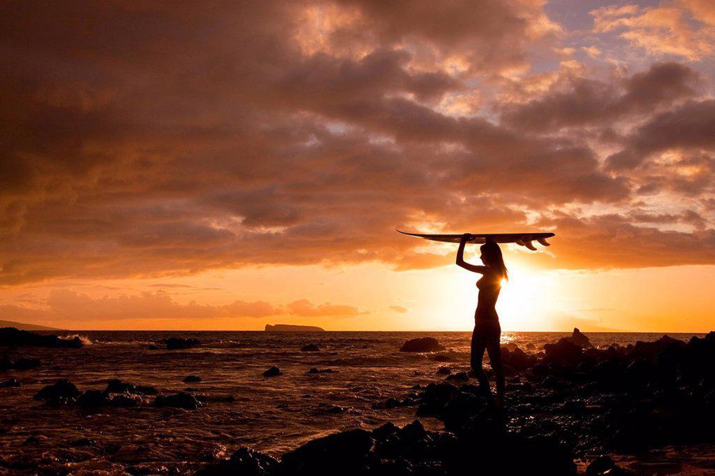 Hawaii, Maui, Makena, Silhouette of surfer girl at sunset : Stock Photo