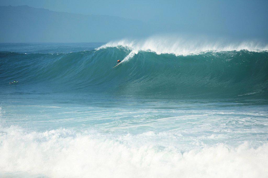 Stock Photo: 1760-13323 Hawaii, Oahu, North Shore, Waimea Bay, Surfer on a huge wave.