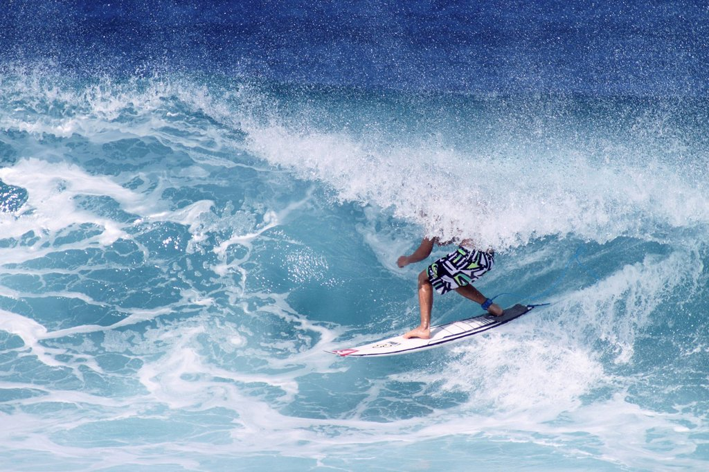 Hawaii, Oahu, North Shore, Surfer riding wave. : Stock Photo