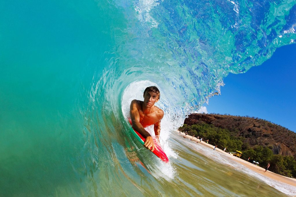 Stock Photo: 1760-13354 Hawaii, Maui, Makena _ Big Beach, Boogie boarder riding barrel of beautiful wave along shore.