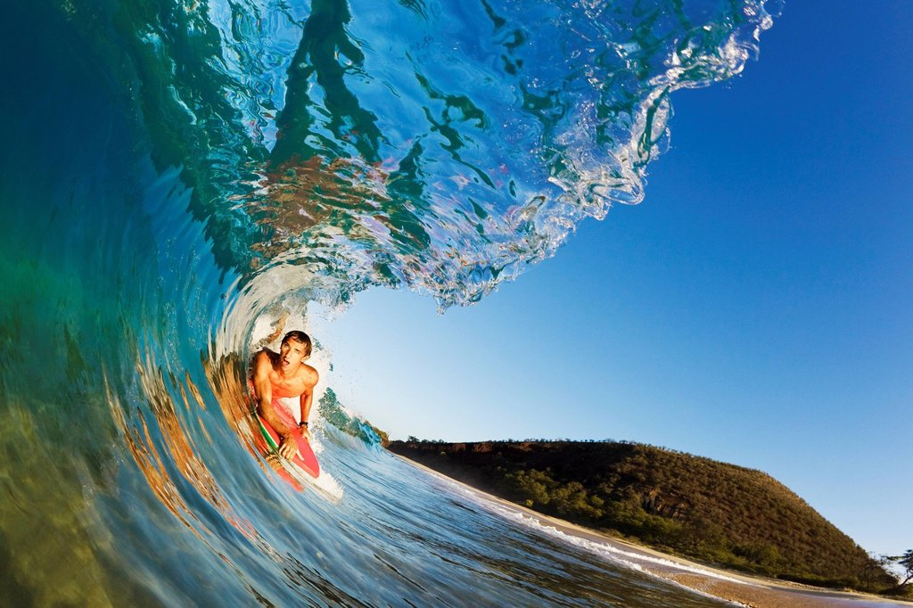 Stock Photo: 1760-13355 Hawaii, Maui, Makena _ Big Beach, Boogie boarder riding barrel of beautiful wave, Sunrise light.