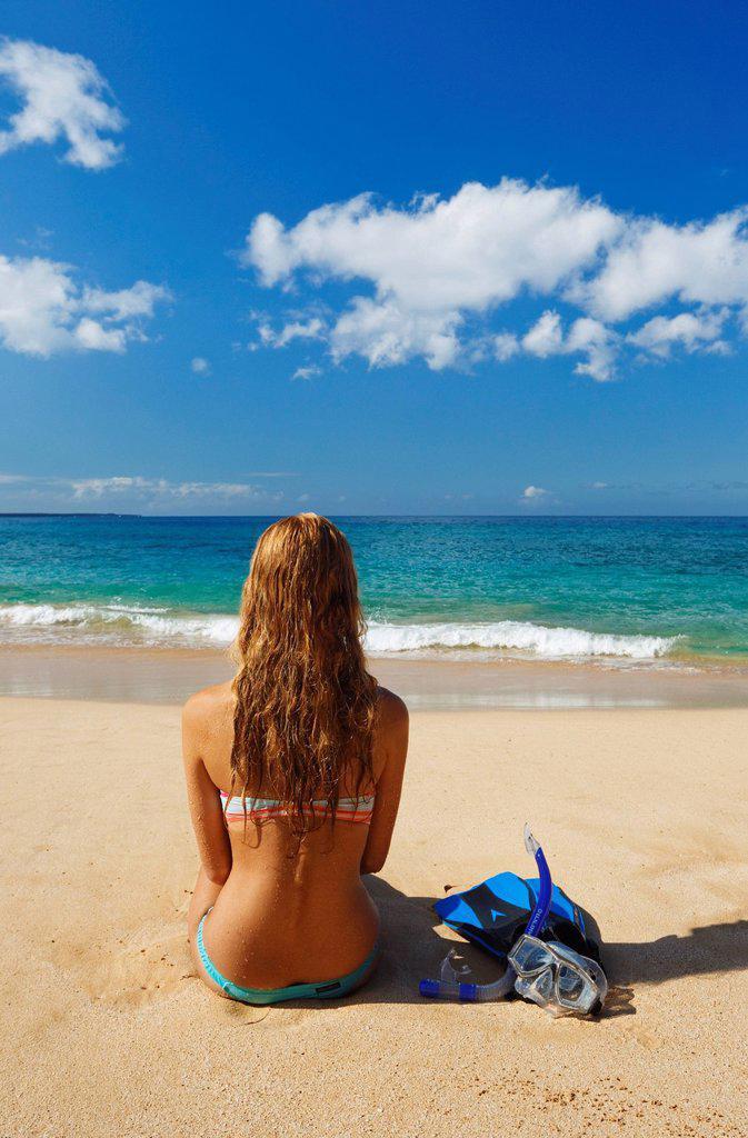 Hawaii, Maui, Makena _ Big Beach, Beautiful woman with snorkel gear along sandy shore. : Stock Photo