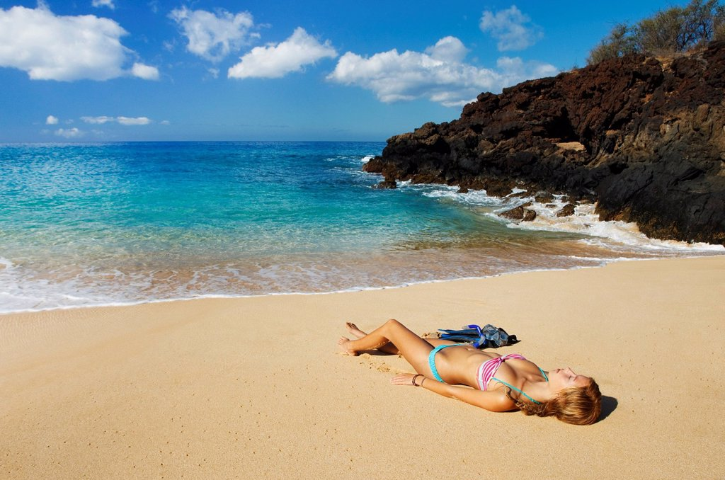Hawaii, Maui, Makena _ Big Beach, Beautiful woman with snorkel gear relaxing on sandy shore. : Stock Photo