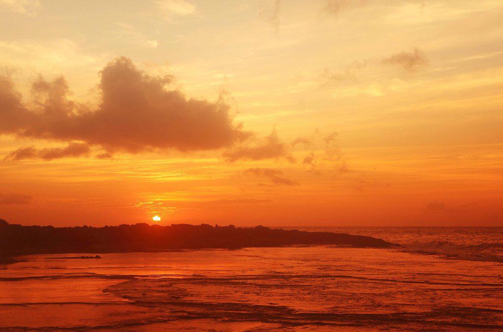 Hawaii, Orange sunset over coast. : Stock Photo