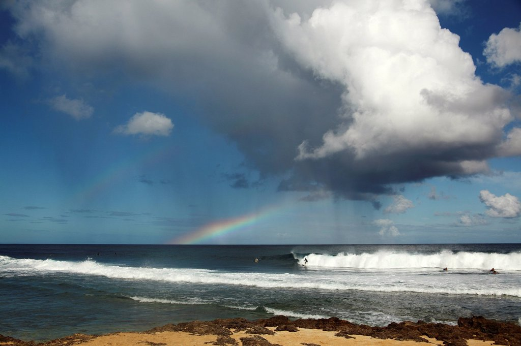 Hawaii, Oahu, Rocky Point, rain and rainbows above ocean. : Stock Photo