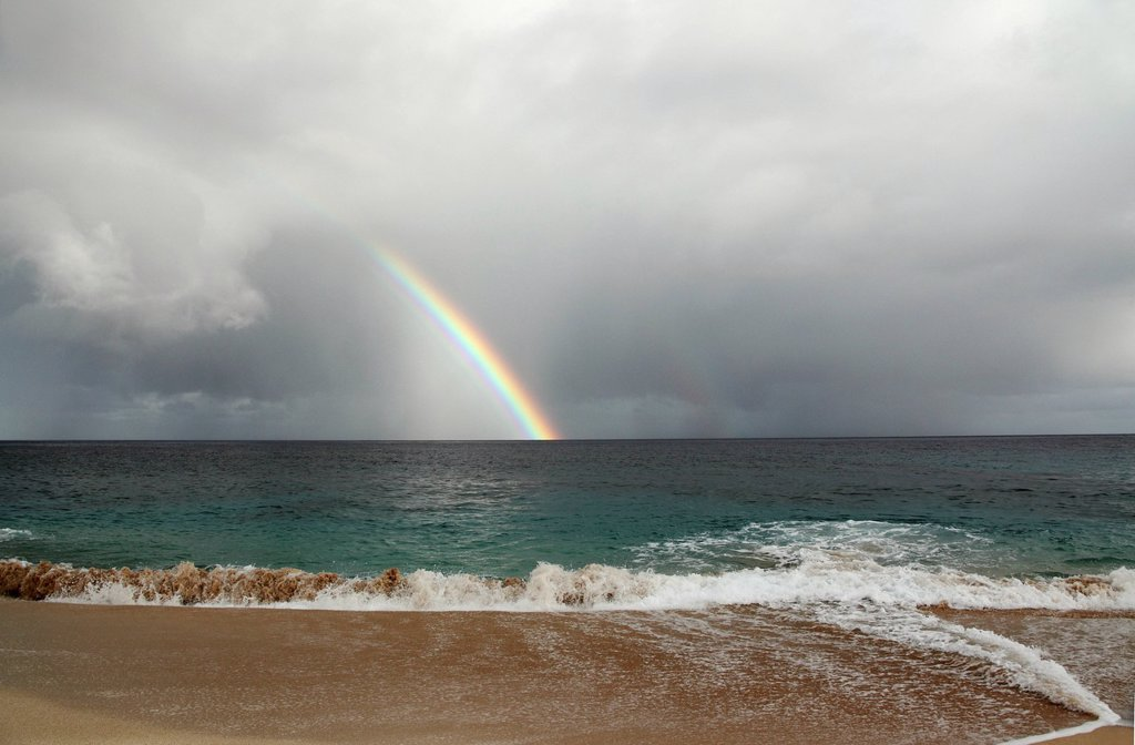 Stock Photo: 1760-13538 Hawaii, Oahu, North Shore, rain and rainbows above ocean.