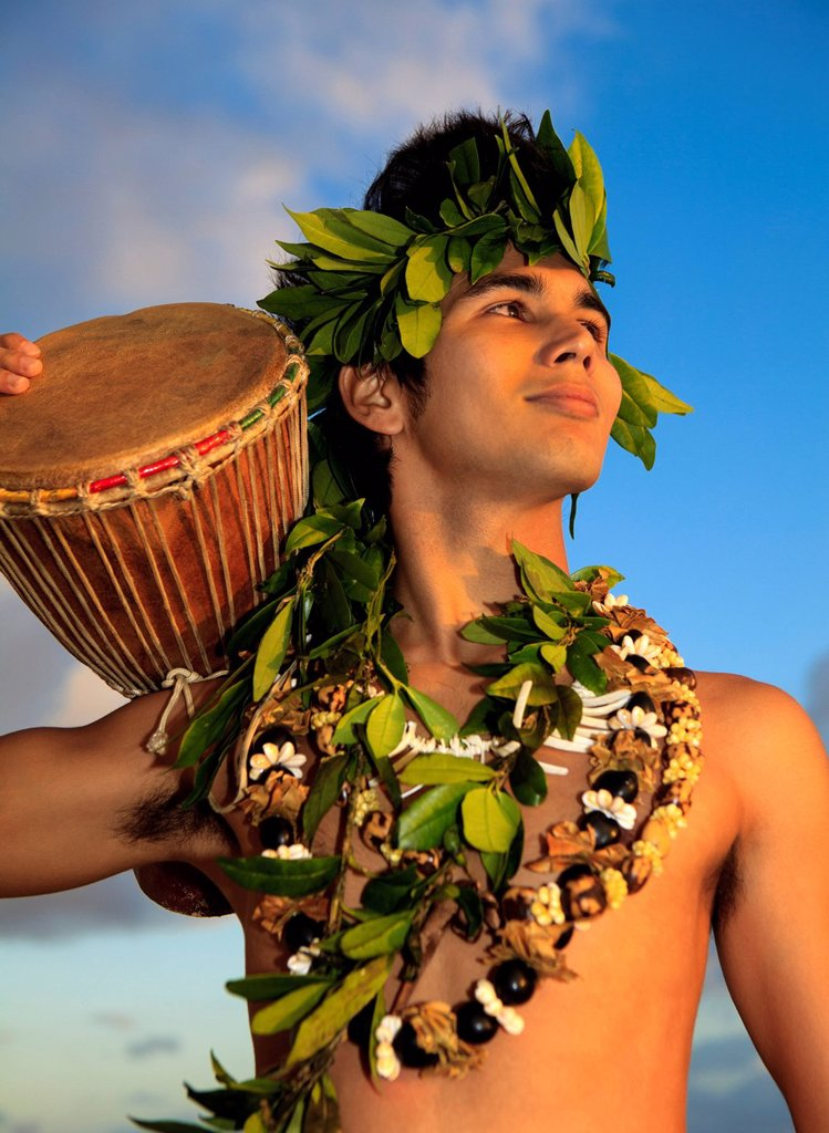 Stock Photo: 1760-13659 Hawaii, Oahu, Polynesian man with drum along coast, Sunrise light.