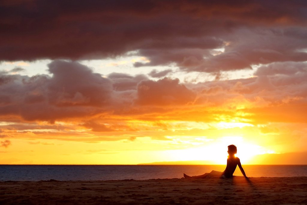 Hawaii, Maui, Makena, Person on beach enjoying beautiful sunset over ocean and shoreline. Editorial Use Only. : Stock Photo