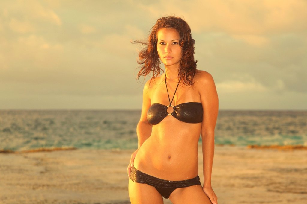 Hawaii, Swimsuit model on beach, Sunset light. : Stock Photo