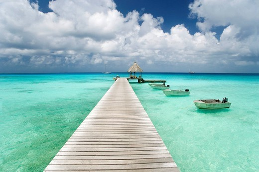 French Polynesia, Tuamotu Islands, Rangiroa Atoll, Resort pier and boats. : Stock Photo