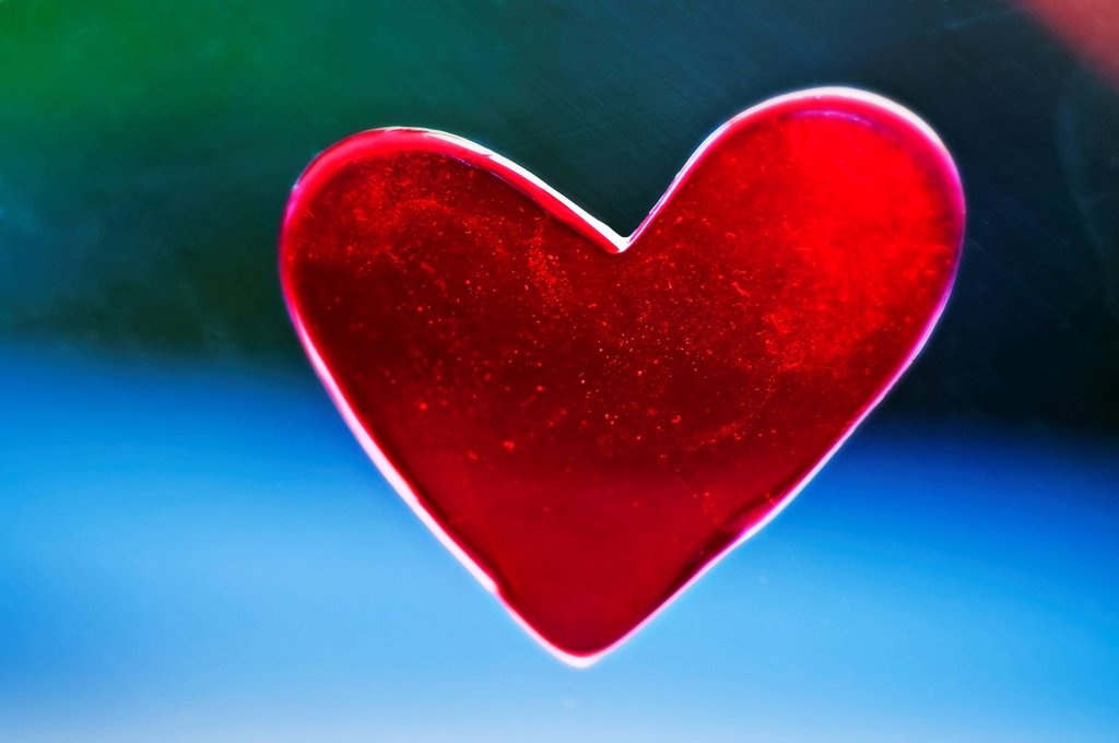Stock Photo: 1760-14787 A heart shaped decoration is placed in window for Valentines Day, Outside background blurred.