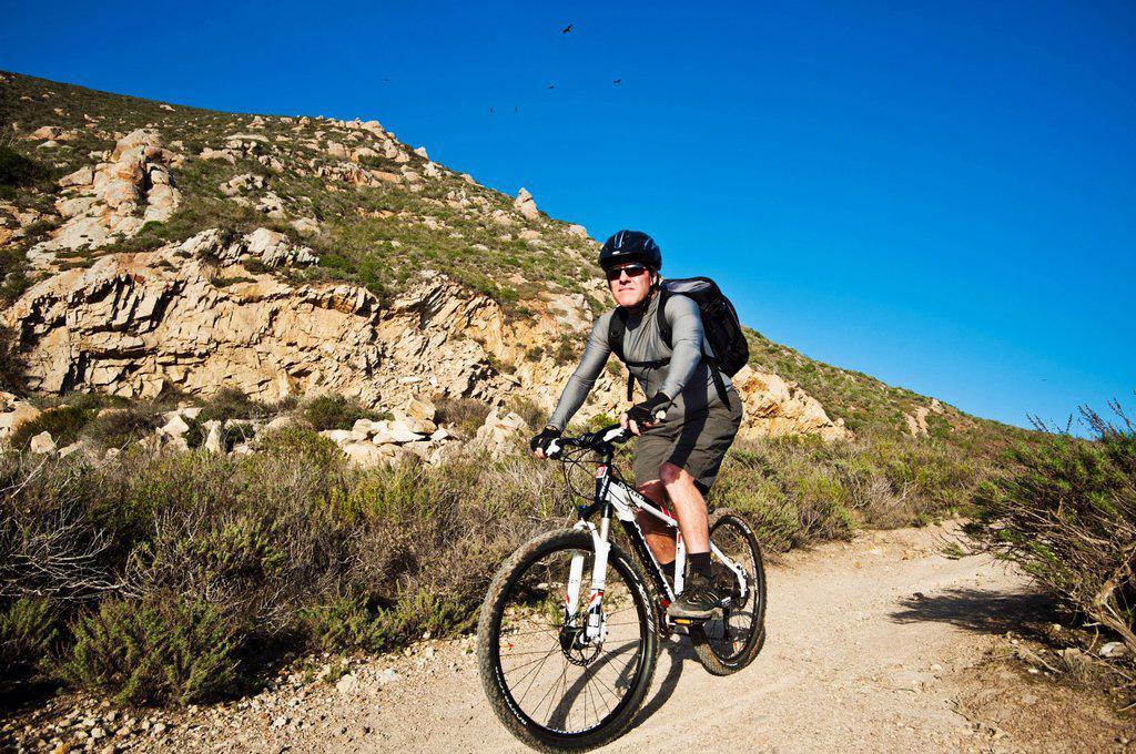 Stock Photo: 1760-14926 California, Morro Bay, Man biking on Quarry Trail.
