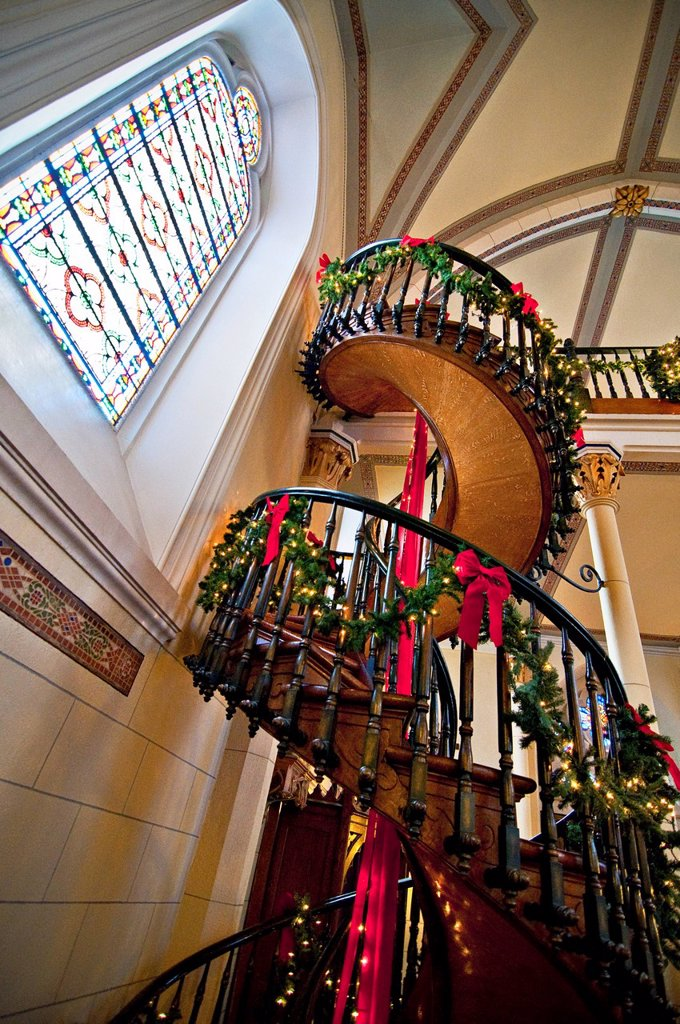 New Mexico, Santa Fe, Loretto Chapel, Spiral miraculous staircase to church balcony _ built between 1873 and 1878, Christmas decorations. Editorial Use Only. : Stock Photo