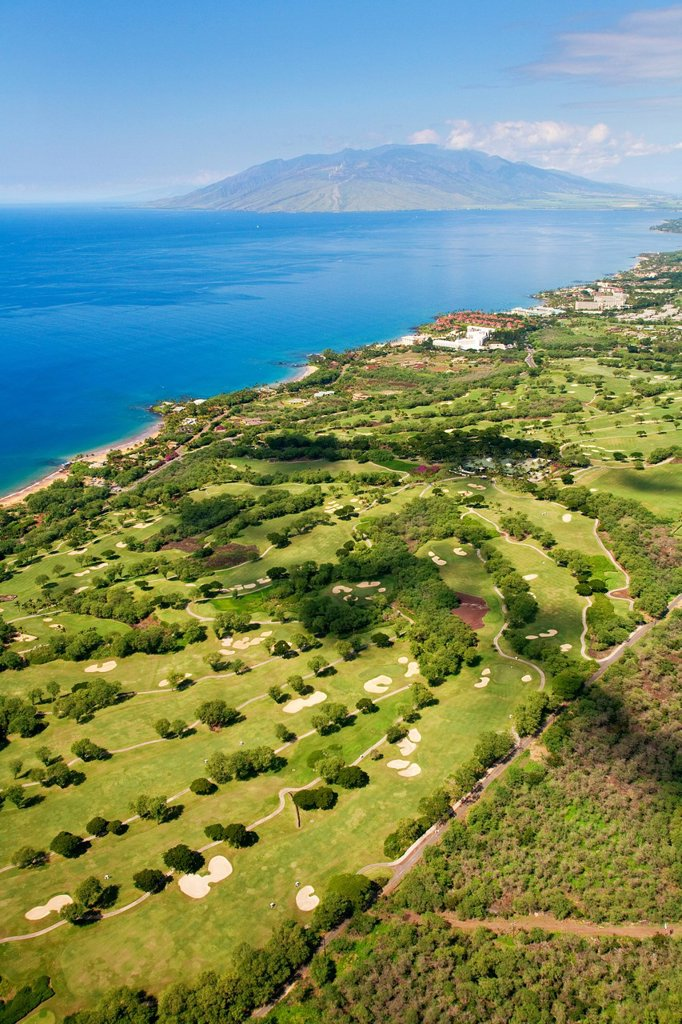 Hawaii, Maui, Aerial of Wailea golf courses, West Maui Mountains in the background. : Stock Photo