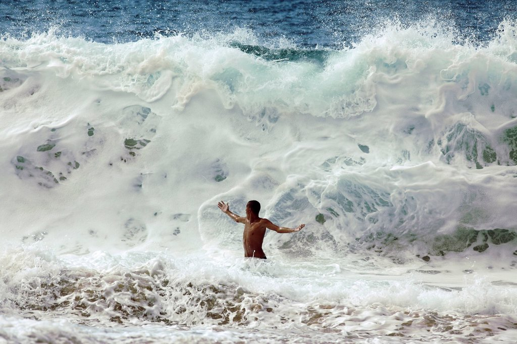 Stock Photo: 1760-15142 Hawaii, Oahu, North Shore, Man is about to be crushed by giant wave.