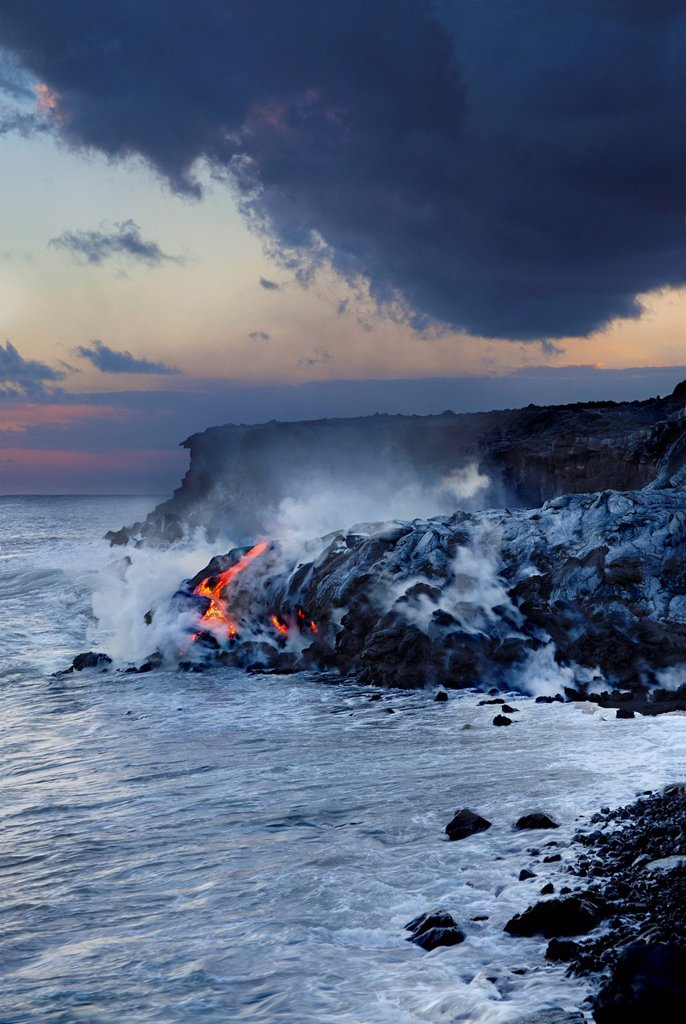 Hawaii, Big Island, Kalapana, Pahoehoe lava flowing from Kilauea reaching the Pacific Ocean. : Stock Photo
