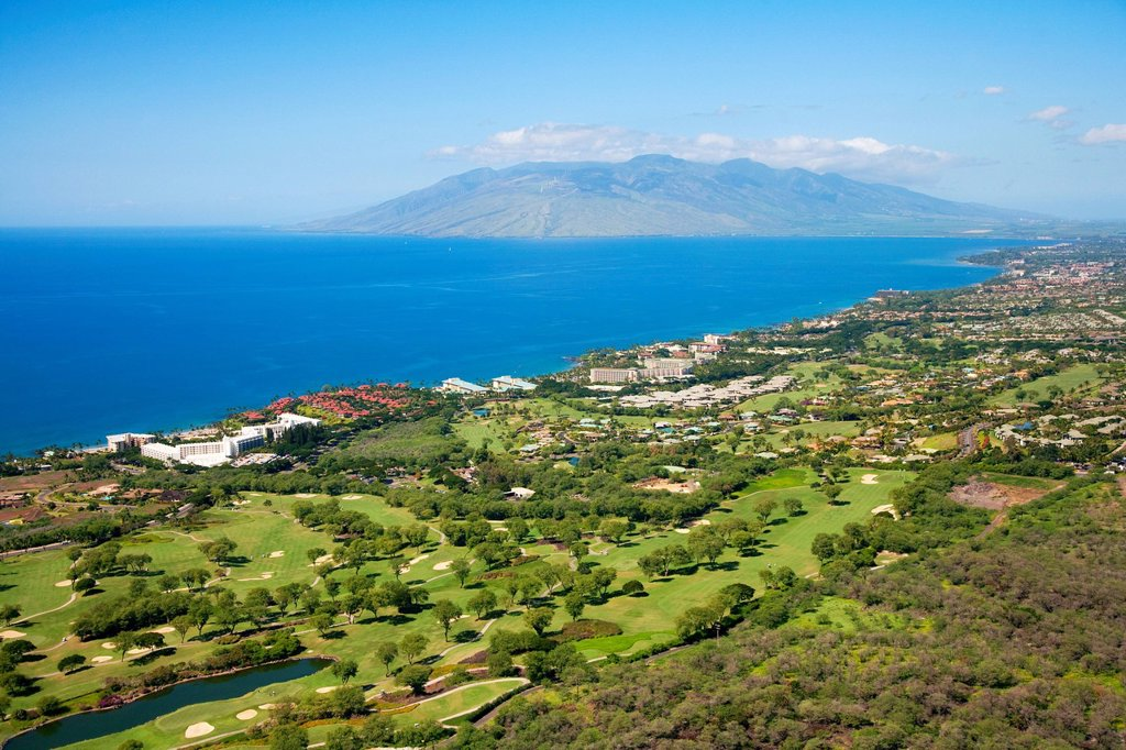 Hawaii, Maui, Wailea coastline, Aerial of Wailea golf courses, West Maui Mountains in the background. : Stock Photo