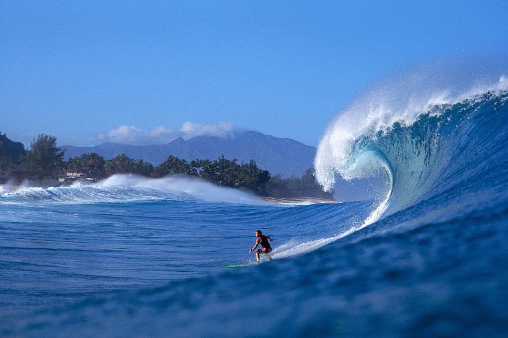 Stock Photo: 1760-1542 Hawaii, NorthShore Oahu, Noah surfs Pipeline, side view of breaking wave B1346