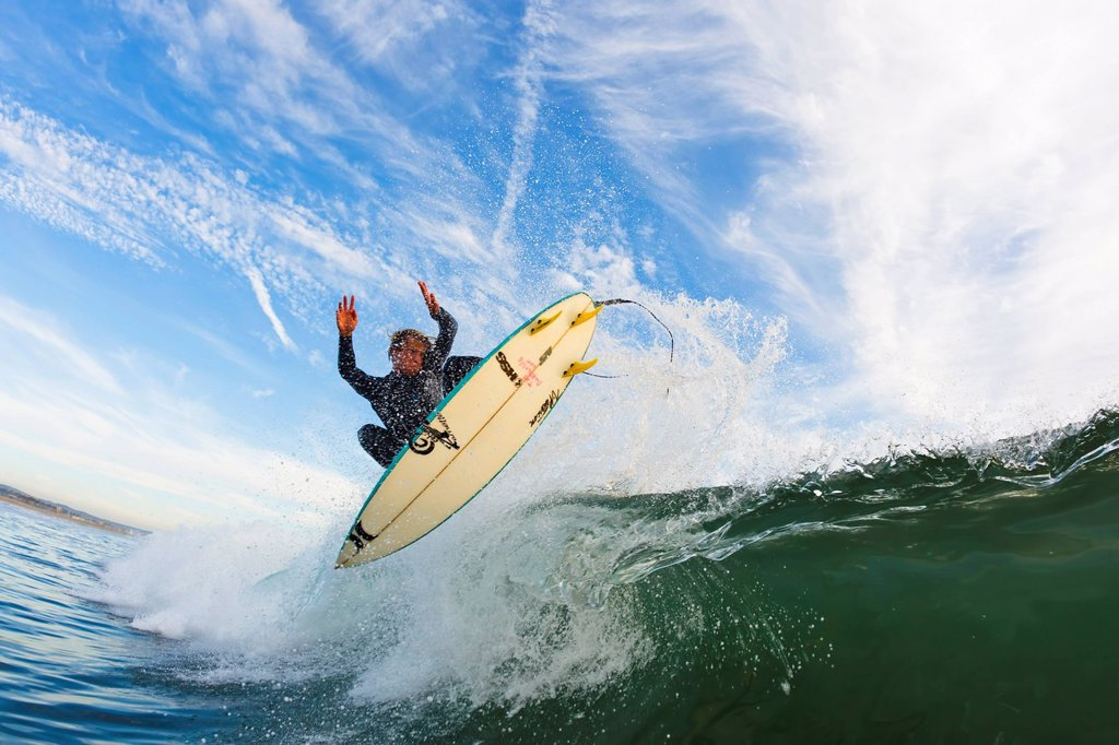 California, Huntington Beach, Surfer catches air on a fun playful wave. FOR EDITORIAL USE ONLY. : Stock Photo