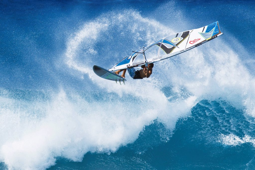 Hawaii, Maui, Ho´okipa, Professional windsurfer Marcilio Browne catches big air off wave. FOR EDITORIAL USE ONLY. : Stock Photo