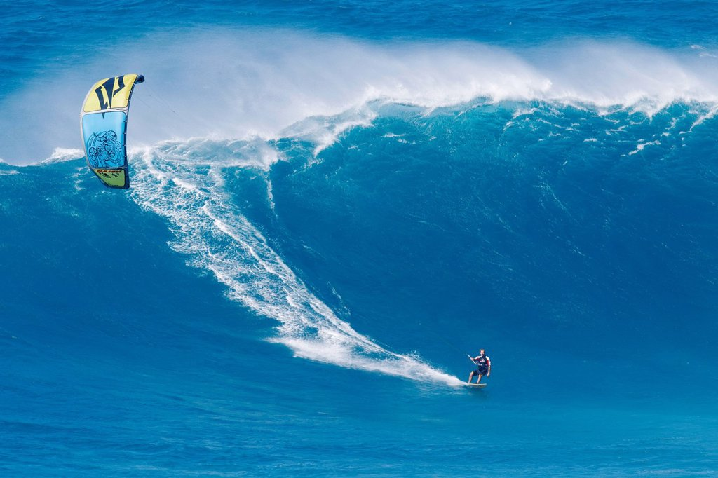 Stock Photo: 1760-15586 Hawaii, Maui, Peahi, Kitebaorder rides a large wave at Peahi, also know as Jaws. FOR EDITORIAL USE ONLY.