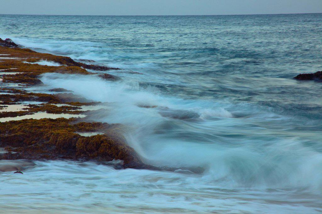 Hawaii, Ocean waves crash on a rocky coastline : Stock Photo