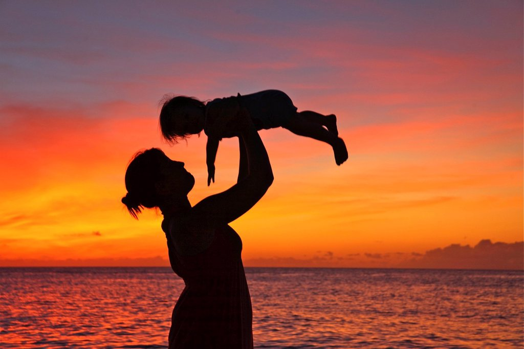 Stock Photo: 1760-15861 Silhouette of a mother and child on the beach