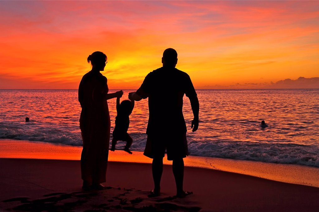 Stock Photo: 1760-15863 Silhouette of a family on the beach.